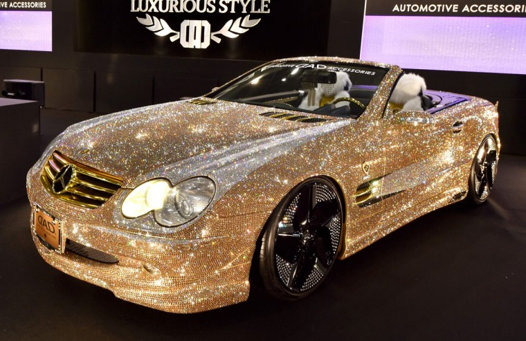Japan's car accessory company Garson displays the demo car Luxury Crystal Benz, the Mercedes-Benz SL600 with Swarovski crystals on the whole body, at Tokyo Auto Salon 2016 at Makuhari Messe in Chiba on January 15, 2016. The exhibition, one of the largest annual custom car and car-related product show, held here over the three-day period from January 15 to January 17. (AFP Photo/Kazuhiro )