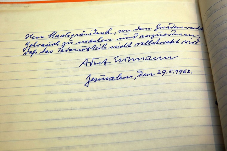 "A picture taken on January 27, 2016 shows the last page of a decades-old handwritten plea from Nazi war criminal Adolf Eichmann for clemency for his role in the Holocaust, as the letter is exposed to the public from the archives of Israeli Presidents Office Legal Department during a ceremony marking 55 years since Eichmann's trial at the occasion of the International Holocaust Remembrance Day at the presidential compound in Jerusalem. during International Holocaust Remembrance Day special event marking 55 years since the trial of Adolf Eichmann at the presidential compound in Jerusalem. In his request to the serving President of Israel, Yitzhak Ben-Zvi, Eichmann wrote: ""It is not true that I was personally of such a high rank as to be able to persecute, or that I myself was a persecutor in the pursuit of the Jews, in the face of such an abundant rule it is clear the judges in their ruling ignored the fact that I never served in such a high position as required to be involved independently in such decisive responsibilities. Nor did I give any order in my own name, but only ever acted by order of. The letter was signed and dated: ""Adolf Eichmann Jerusalem, May 29, 1962."" (AFP Photo / Gali Tibbon)"