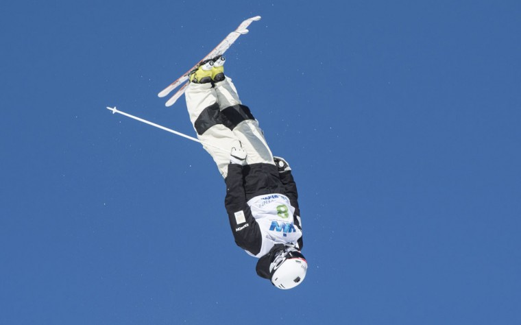Matt Graham of Australia performs a jump in the qualifying round to go on to win second place in the men's moguls at the FIS Freestyle Ski World Cup on Saturday, Jan. 23, 2016, in Val Saint-Come, Canada. (Paul Chiasson/The Canadian Press via AP)