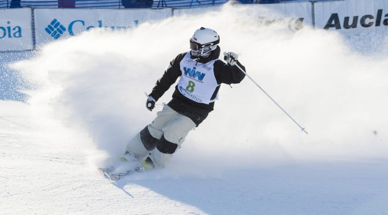 Matt Graham of Australia breaks after crossing the finish line in the super final to place second in the men's moguls competition at the FIS Freestyle Ski World Cup on Saturday, Jan. 23, 2016, in Val Saint-Come, Canada. (Paul Chiasson/The Canadian Press via AP)