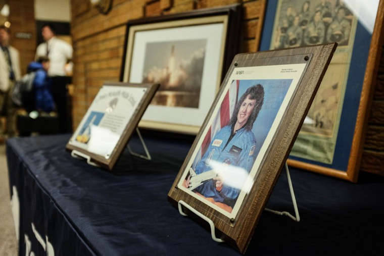 A display in the lobby of Christa McAuliffe Middle School in Bay County's Bangor Township, Mich., Thursday, Jan. 28, 2016, honors the teacher-astronaut who died in the Challenger explosion 30 years ago. (Andrew Dodson/The Bay City Times via AP)