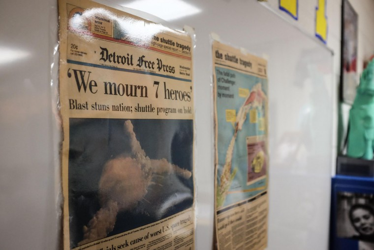 Newspapers from 30 years ago documenting the Challenger explosion hang in Jennifer Gradowski's eighth grade classroom at Christa McAuliffe Middle School, Thursday, Jan. 28, 2016, in Bangor Township, Mich. Thursday marks the space shuttle accident's 30th anniversary. (Andrew Dodson/The Bay City Times via AP)