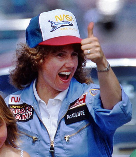 In this 1985 photo, high school teacher Christa McAuliffe gives a thumbs-up during a parade down Main Street in Concord, N.H. McAuliffe was one of seven crew members killed in the Space Shuttle Challenger explosion on Jan. 28, 1986. (AP Photo/Jim Cole)