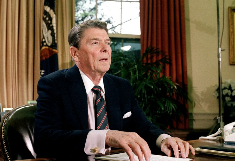 This Jan. 28, 1986 file picture shows U.S. President Ronald Reagan in the Oval Office of the White House after a televised address to the nation about the space shuttle Challenger explosion. (AP Photo/Dennis Cook)