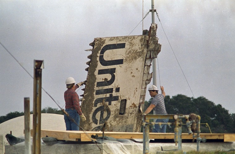 In this 1986 file photo, workers transport debris from the space shuttle Challenger, recovered after the Jan. 28, 1986 explosion, to a storage site on the Canaveral Air Force Station in Cape Canaveral, Fla. (AP Photo/James Neihouse)