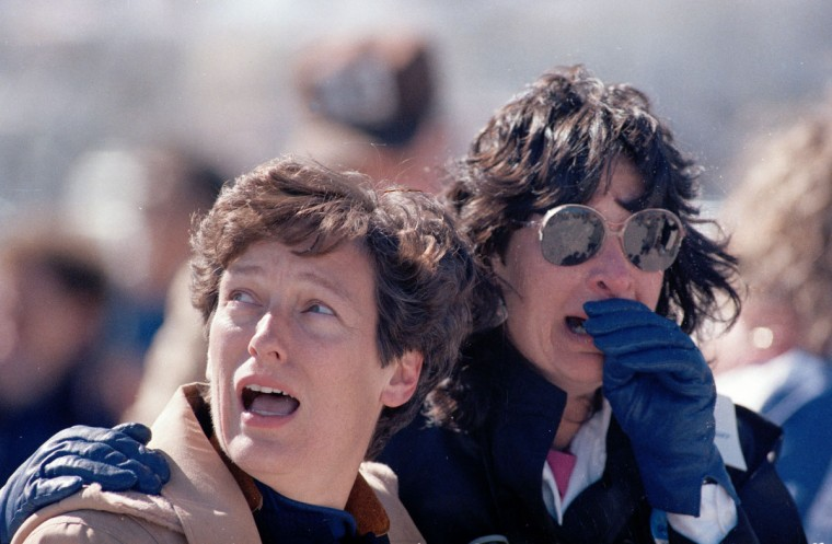 In this Jan. 28, 1986 file picture, spectators at the Kennedy Space Center in Cape Canaveral, Fla. react after they witnessed the explosion of the space shuttle Challenger. (AP Photo/File)