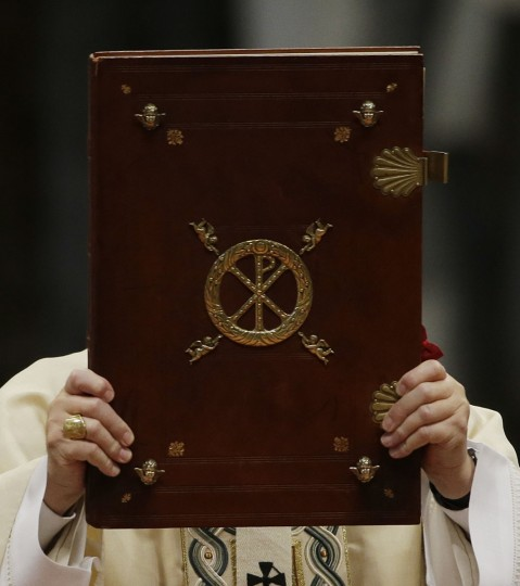 Pope Francis holds the book of the gospel as he celebrates a Mass in St. Peter's Basilica, at the Vatican, to mark Epiphany, Wednesday, Jan. 6, 2016. The Epiphany day is a joyous day for Catholics in which they recall the journey of the Three Kings, or Magi, to pay homage to Baby Jesus (AP Photo/Gregorio Borgia)
