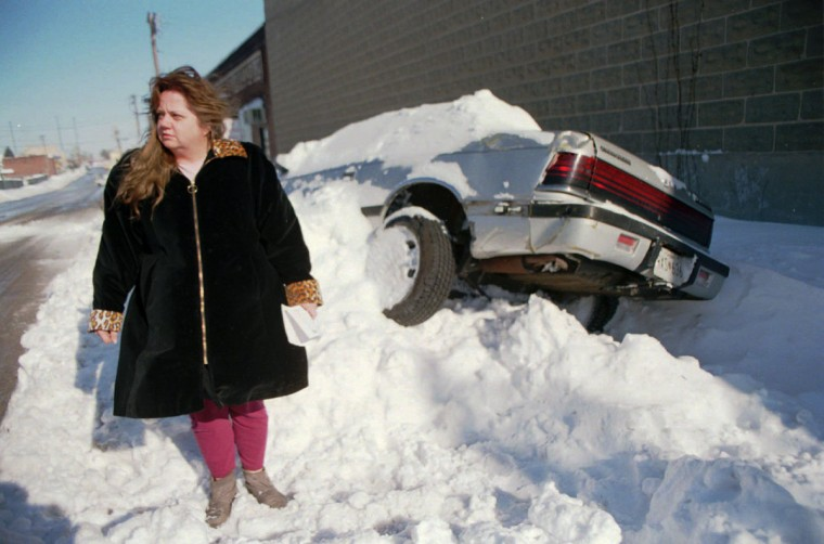 Drema Anderson's 1988 Chrysler LeBaron was hit by a snowplow on the 100 block of N. Haven St. (Jed Kirschbaum/Baltimore Sun)