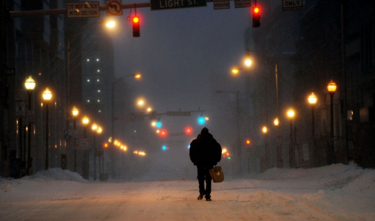 Edward Nelson walks on Baltimore Street during the blizzard Saturday morning. Nelson, who is homeless, is searching for somewhere to keep warm. He says he'll probably go to Lexington Market. (Kim Hairston / Baltimore Sun)