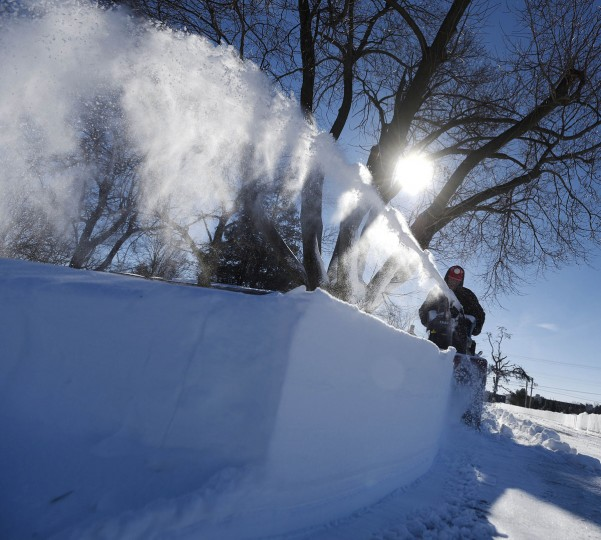 Ron Glacken clears Fowler Road in Westminster Sunday, Jan. 24. (Dylan Slagle/Carroll County Times)