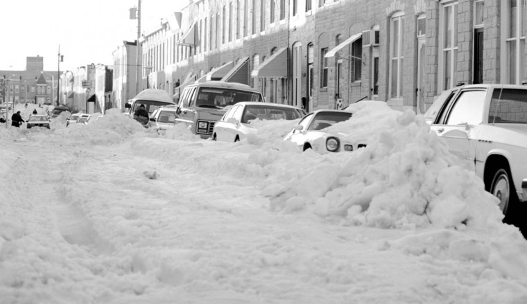 George Balog insists that 98% of the city roads are plowed. That may be so, but many of the roads are 1 lane and some in Highland Town still haven't been touched. Shown is Mt. Pleasant Street off Pratt Street which still appears to have snow on it from Sunday's blizzard. (Gene Sweeney Jr./Baltimore Sun)