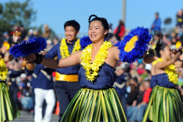 The Punahou School marching band and dancers from Honolulu perform in the 127th Rose Parade in Pasadena, Calif., Friday, Jan. 1, 2016.(AP Photo/Michael Owen Baker)