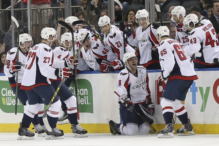 Washington Capitals left wing Alex Ovechkin (8) celebrates with his teammates after scoring the game-winning goal during overtime of an NHL hockey game against the New York Rangers, Saturday, Jan. 9, 2016, at Madison Square Garden in New York. The Capitals won 4-3. (Mary Altaffer/Associated Press)