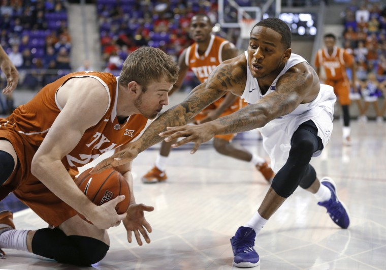 Texas forward Connor Lammert, left, grabs a loose ball next to TCU guard Malique Trent during the first half of an NCAA college basketball game Saturday, Jan. 9, 2016, in Fort Worth, Texas. (Ron Jenkins/Associated Press)