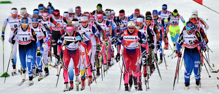 "Athlets competes in the Women's 10 km Mass Start classic competition of the ""Tour de Ski"" Cross Country World Cup on January 9, 2016 in the Lake Tesrero track of Val Di Fiemme. Norway's Heidi Weng won the race ahead of Norway's second-placed Ingvild Flugstad Oestberg Johaug and third-placed Therese Johaug. (GIUSEPPE CACACE/AFP/Getty Images)"
