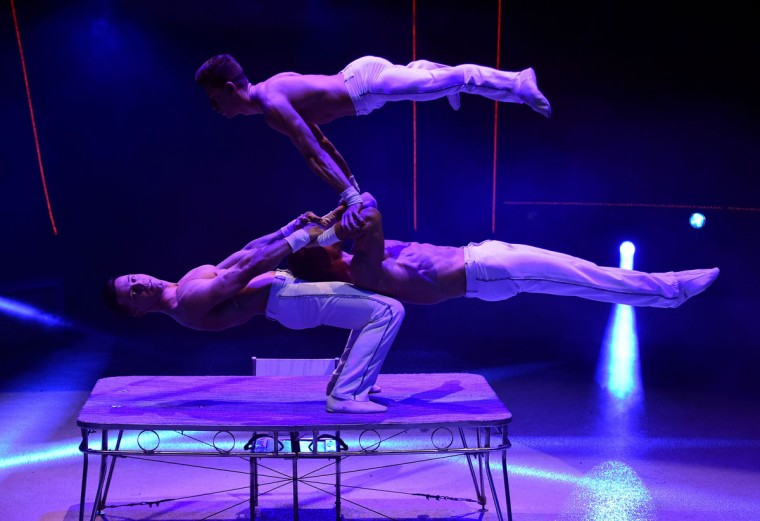 Members of the 'X-Treme Brothers' group perform at the Capital Circus during the 11th edition of the International Circus Festival on January 8, 2016 in Budapest. The festival takes place from January 7 to 11, 2016. (ATTILA KISBENEDEK/AFP/Getty Images)