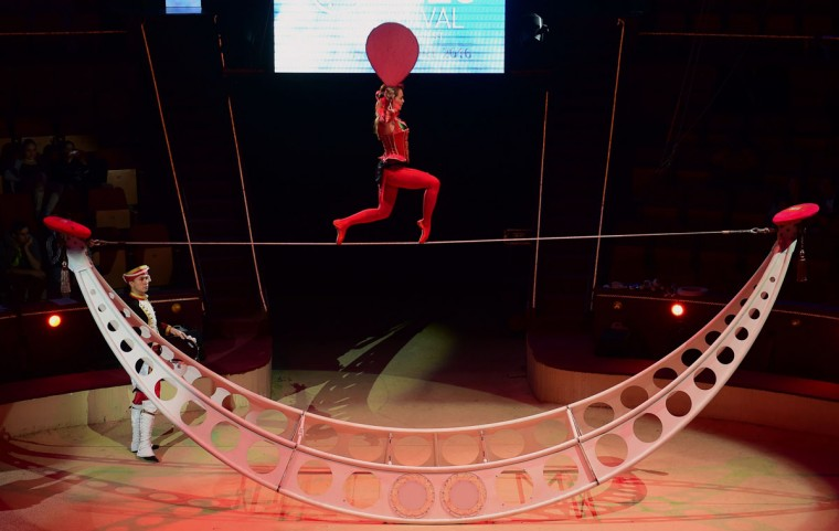 Members of the Russian Duo Phykov perform at the Capital Circus during the 11th edition of the International Circus Festival on January 7, 2016 in Budapest. The festival takes place from January 7 to 11, 2016. (ATTILA KISBENEDEK/AFP/Getty Images)