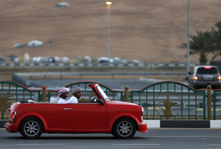 Emiratis drive a British made Mini on January 7, 2016, during the Liwa 2016 Moreeb Dune Festival in the Liwa desert, some 250 kilometers southwest of Abu Dhabi. (KARIM SAHIB/AFP/Getty Images)