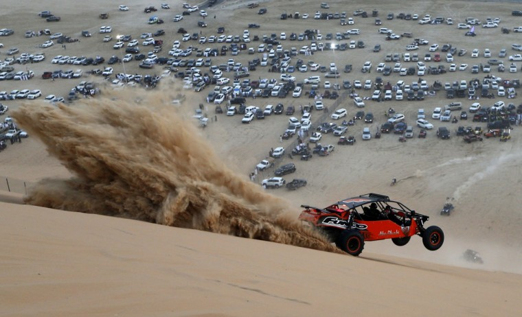 A dune buggy driver trains before competing in a sand dune drag racing event on January 8, 2016, as part of the Liwa 2016 Moreeb Dune Festival in the Liwa desert, some 250 kilometers southwest of Abu Dhabi. (KARIM SAHIB/AFP/Getty Images)