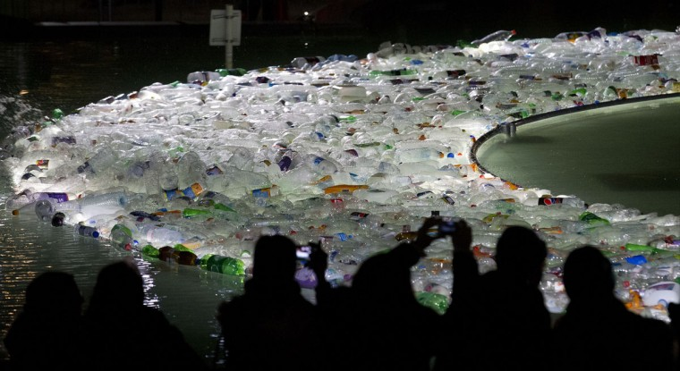 Plastic Islands by Spanish collective Luzinterruptus is on show in Trafalgar square fountain as part of the lumiere light festival in London on January 14, 2016. London hosts a festival that brings together international light artists to create installations across the capital. (JUSTIN TALLIS/AFP/Getty Images)