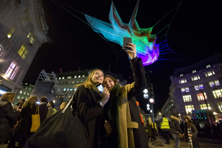 Spectators take a selfie under 1.8 London by US artist Janet Echelman on show as part of the lumiere light festival in London on January 14, 2016. London hosts a festival that brings together international light artists to create installations across the capital. (JUSTIN TALLIS/AFP/Getty Images)