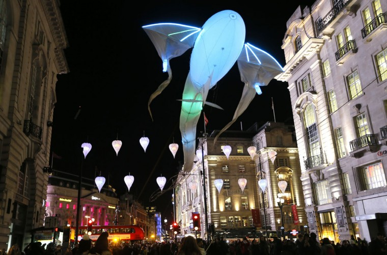 'Les Lumineoles' by artist 'Porte Par Le Vent flies above Piccadilly in London, Thursday, Jan. 14, 2016. Lumiere London is a festival of lights across 30 London locations, showing installations, projections and interactive pieces, the festival runs until Jan. 17. and is expected to attract thousands of visitors. (AP Photo/Kirsty Wigglesworth)