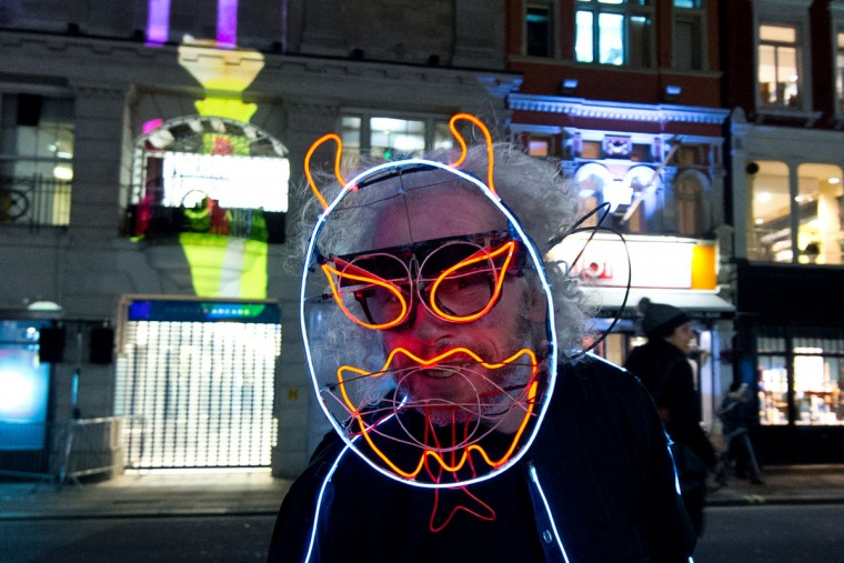 A man in fancy dress walks along Piccadilly during the Lumiere London exhibition on January 14, 2016 in London, England. The first Lumiere exhibition in London is a free festival of light with exhibits placed in 30 locations across the capital. The event will run from January 14 to January 17. (Photo by Ben Pruchnie/Getty Images)