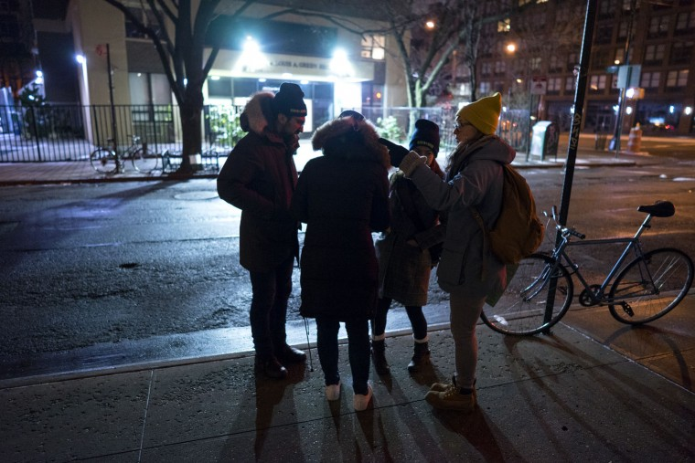 From left, Edward Casabian, Victoria Parker, Alexis Sypek and Ashley Treni, all from New York and working with The Robin Hood Foundation, an organization that helps the poor, plan their route as they take part in a count and survey of homeless persons on the streets of New York early Tuesday, Feb. 9, 2016. Hundreds of people fanned out across the city to conduct the survey just after midnight. (AP Photo/Craig Ruttle)