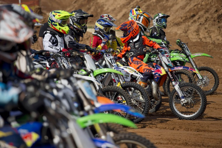 Riders get ready to drive during a pre race for the inauguration of the first official Motocross track the MX Wingate cross country race track near Netanya, Israel, Thursday, Feb. 11, 2016. (AP Photo/Ariel Schalit)
