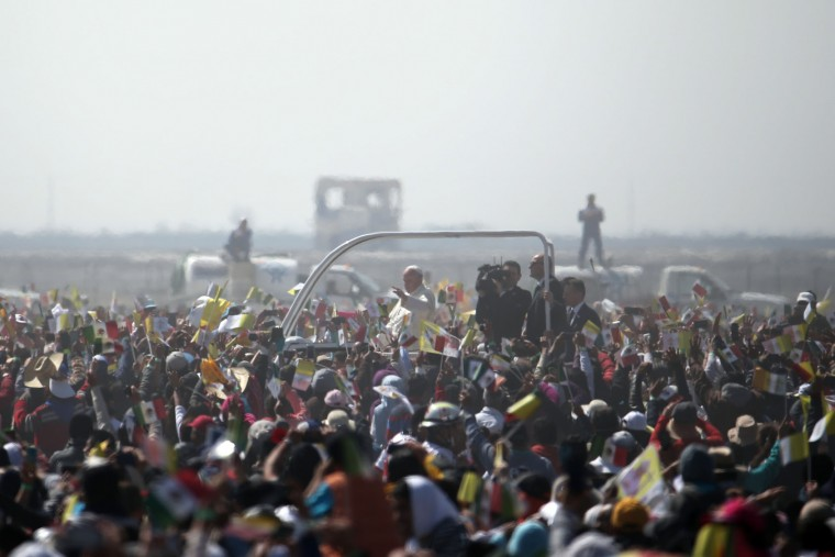 Pope Francis rides on a popemobile as he makes his way through pilgrims waiting for Mass in Ecatepec, Mexico, Sunday, Feb. 14, 2016. Pope Francis will give a Mass at an outdoor field in the capital's suburb of Ecatepec to an estimated crowd of 400,000 pilgrims. It is to be his biggest event during his trip to Mexico. (AP Photo/Dario Lopez-Mills)