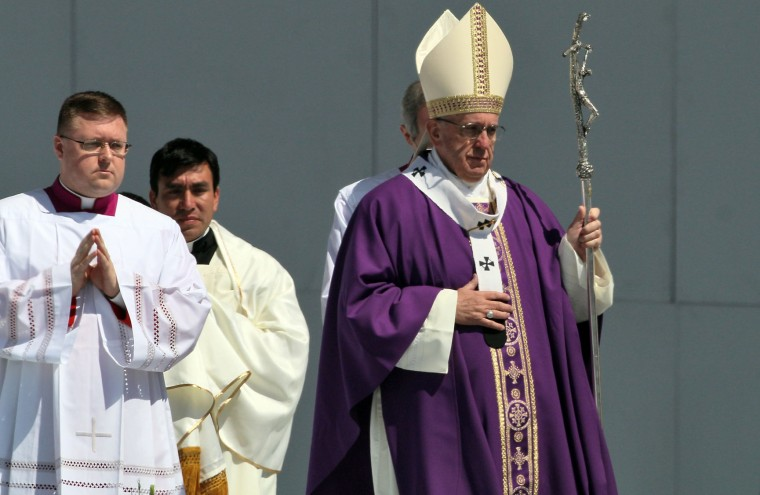 Pope Francis celebrates an open-air mass in Ecatepec --a rough, crime-plagued Mexico City suburb-- on February 14, 2016. Pope Francis has chosen to visit some of Mexico's most troubled regions during his five-day trip to the world's second most populous Catholic country. (Hector Guerrero/AFP/Getty Images)