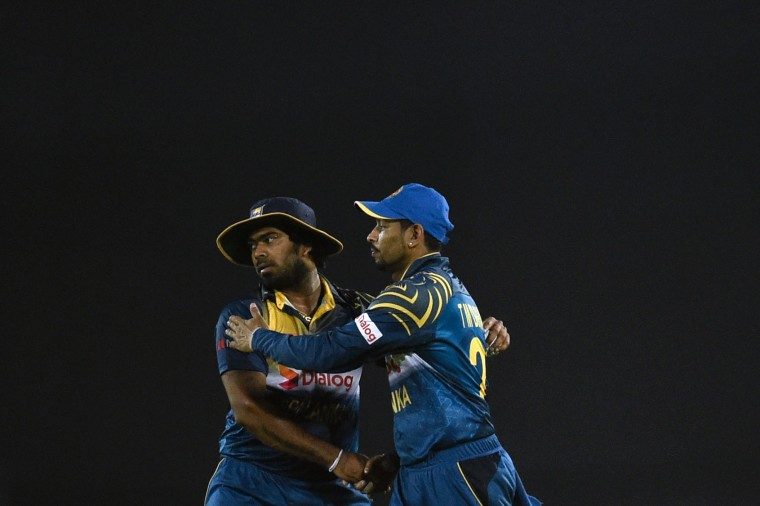 Sri Lankan cricket captain Lasith Malinga (L) shakes hand with teeammate Tillakaratne Dilshan (R) after winning their match against United Arab Emirates at the Asia Cup T20 (Twenty20) cricket tournament at the Sher-e-Bangla National Cricket Stadium in Dhaka on February 25, 2016. (Munir uz Zaman/AFP/Getty Images)