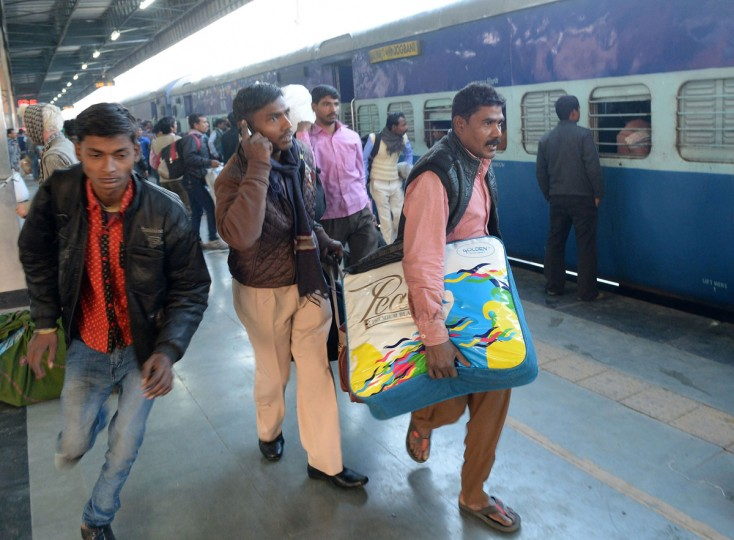 Indian passengers rush to board The Simanchal Express at Anand Vihar Railway Station in New Delhi on February 25, 2016. Indian Railways Minister Suresh Prabhu is set to announce the Indian Railways Budget in the country's parliament. (PRAKASH SINGH/AFP/Getty Images)