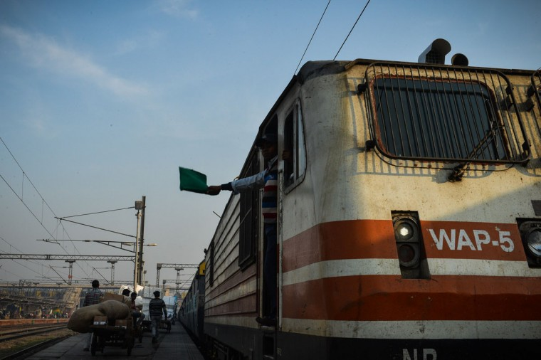 An Indian train driver flags off a train from Hazrat Nizamuddin railway station in New Delhi on February 25,2016. Indian Railway minister Suresh Prabhu is set to announce the Indian Railways Budget on February 25. (Chandan Khanna/AFP/Getty Images)