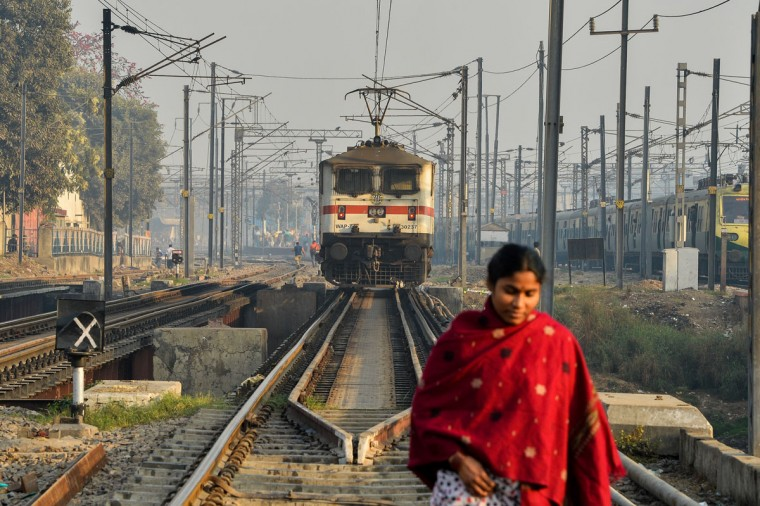An Indian woman crosses rail tracks near Hazrat Nizamuddin railway station in New Delhi on February 25,2016. Indian Railway minister Suresh Prabhu is set to announce the Indian Railways Budget on February 25. (Chandan Khanna/AFP/Getty Images)