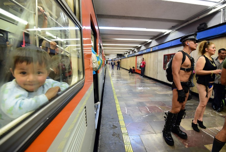 People stand in a subway station during the worldwide 'No Pants Subway Ride' event in Mexico City on February 21, 2016. Organized by New York City-based prank collective Improv Everywhere, the annual event was launched in 2002 and has since spread to more than 60 cities. (ALFREDO ESTRELLA/AFP/Getty Images)