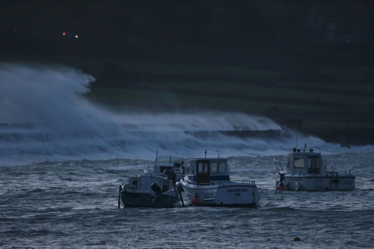 Boats are seen in the harbor in Auderville, northwestern France, on February 8, 2016, as strong winds hit the region. (CHARLY TRIBALLEAU/AFP/Getty Images)