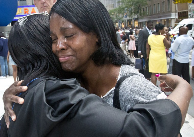 "In this June 9, 2015 photo, Candie Hailey, right, cries as she hugs her younger sister, Chyna, following her college graduation ceremonies in New York. ""I am proud of you,"" said Candie. ""We been through a lot."" Hailey dropped out of high school to help care for Chyna and another sister, and later earned an equivalency diploma and a college degree before Rikers Island prison made her a ""solitary survivor."" (AP Photo/Bebeto Matthews)"