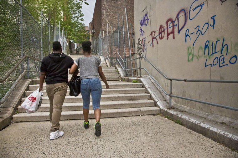 "In this Friday, May 22, 2015 photo, Candie Hailey, right, holds onto Timothy, her best friend's brother, after visiting her father's Bronx apartment in New York. ""He's just looking out for me, like a bodyguard,"" said Hailey, welcoming Timothy's companionship and a sense of protection, as she fears confronting the accusers responsible for her incarceration at Rikers Island, who all still live in the neighborhood. Hailey, who spent 2 1/3 years in solitary, was set free after more than three years following a not guilty verdict in a jury trial. (AP Photo/Bebeto Matthews)"