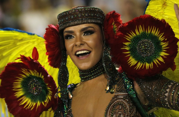 Performers from the Mocidade samba school parade during carnival celebrations at the Sambadrome in Rio de Janeiro, Brazil, Monday, Feb. 8, 2016. (AP Photo/Silvia Izquierdo)