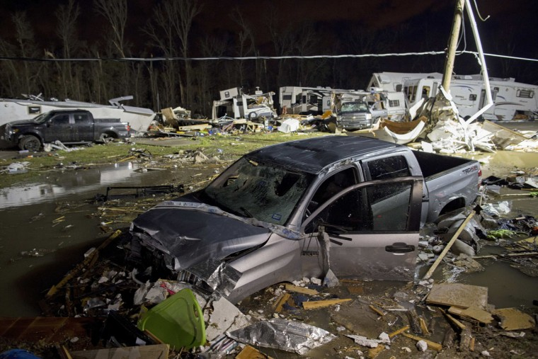 Destroyed trailers and vehicles are all that remain of the Sugar Hill RV Park after a suspected tornado hit the park in Convent, La., Tuesday, Feb. 23, 2016. St. James Parish Sheriff Willy Martin says authorities are using dogs to search piles of rubble left in the wake of the storm to find anyone else still missing under the debris. (AP Photo/Max Becherer)