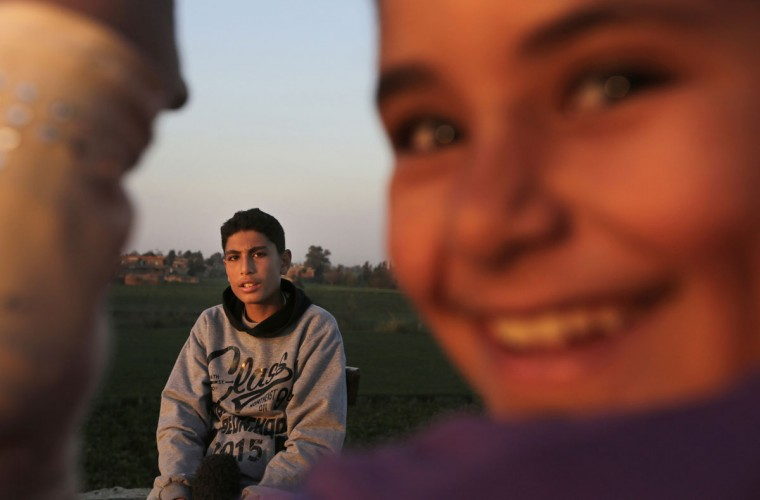 In this Friday, Feb. 5, 2016 picture Egyptian farmer, Ahmed Ayman, 14, speaks during an interview with the Associated Press in the Nile Delta village of Al-Arid about 150 kilometers north of Cairo, Egypt. Ayman discovered his donkeyís natural talent when she leapt over an irrigation canal one day, and decided to train her. ìWe got a very small barrier, and then would make it higher and higher each day,î he said.(AP Photo/Amr Nabil)