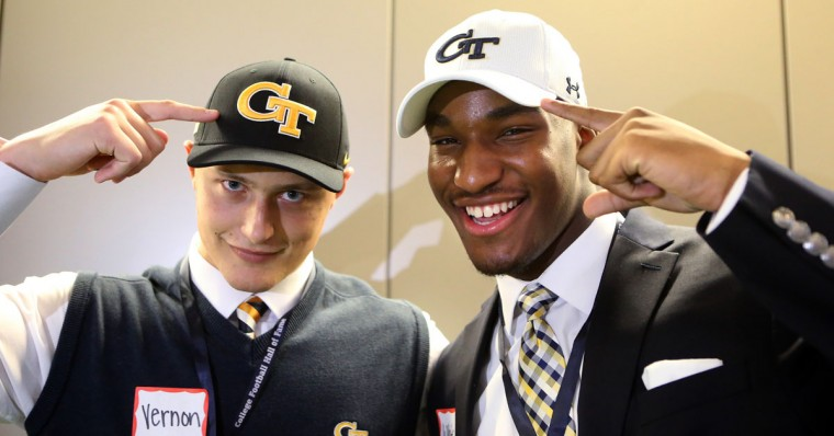 Mill Creek High School defensive end Tyler Vernon and Walton High School defensive end Josh White, who are both headed to Georgia Tech, gesture towards their caps during national signing day at the College Football Hall of Fame, Wednesday, Feb, 3, 2016, in Atlanta. (Curtis Compton/Atlanta Journal-Constitution via AP)