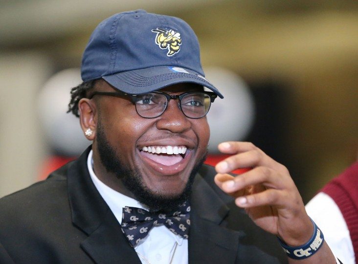 Grayson High School defensive tackle Chris Martin is all smiles sporting his Georgia Tech hat and bow tie during national signing day at the College Football Hall of Fame, Wednesday, Feb, 3, 2016, in Atlanta. (Curtis Compton/Atlanta Journal-Constitution via AP)