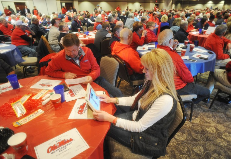 Mississippi football fan Lori Shelly keeps up with football recruiting during an Ole Miss Quarterback Club national signing day event at the Oxford Conference Center in Oxford, Miss., Wednesday, Feb. 3, 2016. (Bruce Newman/The Oxford Eagle via AP)
