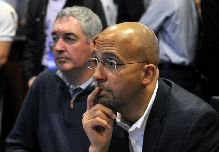 Penn State football head coach James Franklin, front, and offensive coordinator Joe Moorhead wait for letters of intent from recruits on national signing day, Wednesday, Feb. 3, 2016, in State College, Pa. (Nabil K. Mark/Centre Daily Times via AP)