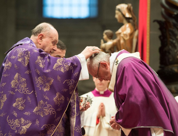 Cardinal Angelo Comastri, left, places the ashes on the head of Pope Francis during the Ash Wednesday mass, in St. Peter's Basilica at the Vatican, Wednesday, Feb. 10, 2016. Pope Francis has smudged ashes on the bowed heads of prelates, nuns and ordinary Catholics during Ash Wednesday Mass in St. Peter's Basilica. The ritual marks the start of Lent, a period of penitence, prayer and self-sacrifice as faithful prepare for Easter. (L'osservatore Romano/Pool Photo via AP)