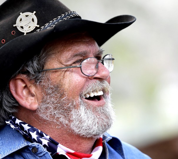 Assistant trail boss Bruce Fraysur laughs during a break in the Sam Houston Trail Ride on Tuesday, Feb. 23, 2016, in Tomball, Texas. More than 3,000 riders from 13 trail rides will converge in Houston on Friday as part of the Houston Livestock Show and Rodeo. The riders will take part in the downtown rodeo parade on Saturday. (AP Photo/David J. Phillip)