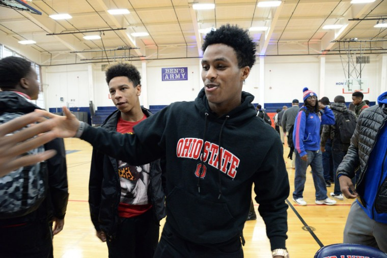 Kareem Felder, a senior at Franklin High School, is congratulated on signing day. He will play football at Ohio State. (Kim Hairston/Baltimore Sun)