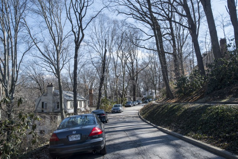 The houses along Longwood Road are tucked below the street level. (Emma Patti Harris/Baltimore Sun)